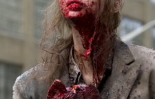 "A zombified extra holds a prop limb, ""The Walking Dead"" June 14, 2011"