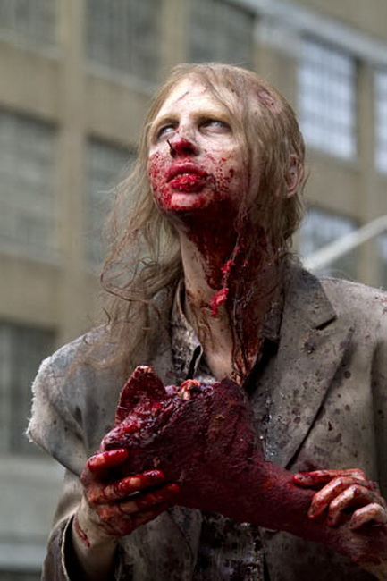 """A zombified extra holds a prop limb, """"The Walking Dead"""" June 14, 2011"""